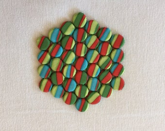 Hexagonal Kitchen Trivet with a Red, Blue, & Green Striped Design