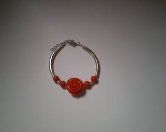 red flower bracelet and silver beads