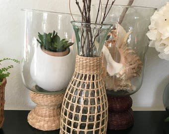 Glass carafe wrapped in straw