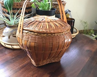 Beautiful vintage wicker basket with lid
