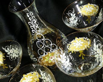 Antique enamel set, decanter and glasses