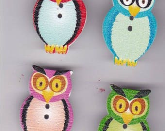 Set of four buttons depicting owls