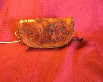 Small purse tan in color hand tooled and hand made