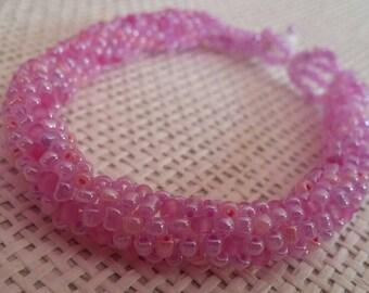Pink woven beaded bracelet