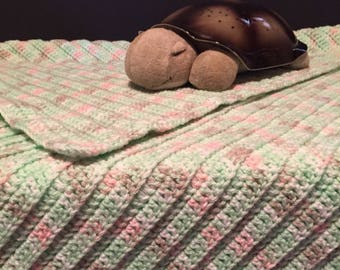 Soft, warm and cozy Crochet mint green with splashes of gray, pink and white baby afghan/blanket