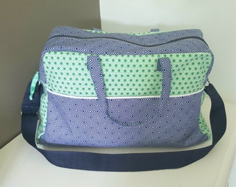 ON order only large diaper bag, green and blue colors Navy, and adjustable shoulder strap