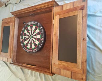 Custom hand crafted dart board cabinet, with 2 pc. Crown  molding. And sill, chaulk brds each door and chaulk tray at bottom