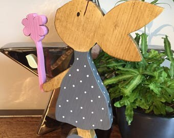Large wooden freestanding Rabbit holding a wooden flower