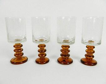 Four midcentury glasses