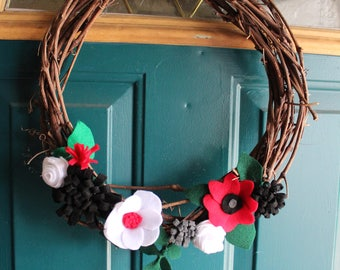 grey, red, black, and white felt flower wreath