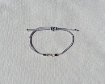 Infinity bracelet with light grey polyester cord and metallic bronze beads