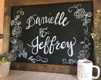 Chalkboard sign with names for wedding