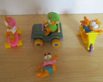 Vintage Toys - 4 Garfield Toys, McDonald's Fast Food Toys, Garfield Skateboard, Garfield Jeep, Garfield Scooter, Garfield Waving, 1980s