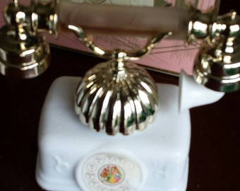 French Telephone by Avon with Moonwind bath Oil and Perfume in the handle