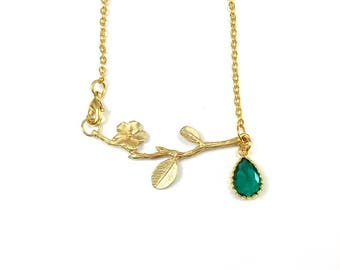 Necklace, plant motive with the emerald crystal ,gold plated.