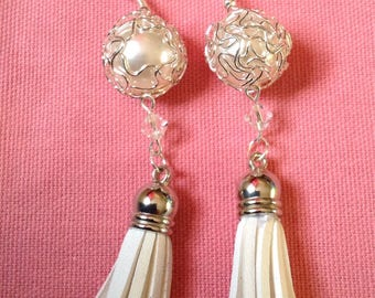 White and silver-tone dangle earrings