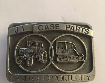 Vintage collectible case tractor belt buckle JI case parts land of opportunity 1986