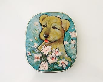 A Sharps Product Maidstone Dog Motif Tin with Flowers, small tin curved edge rectangular tin