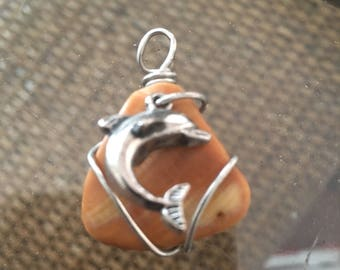 Sea shell like sea glass with Dolphin charm attached