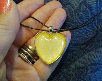 Lemon shimmer heart shaped pendant on leather cord