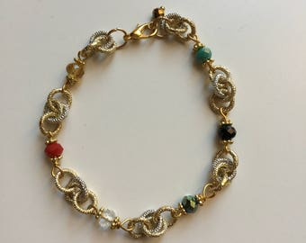 Chainmail bracelet with colored crystals
