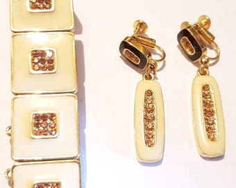 Joel clip on earrings and bracelet set. Vintage earrings and bracelet. Gold and rhinestones clip on earrings set