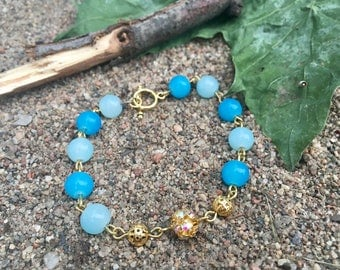 Gold chain strap and two tone blue glass bead