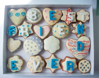 a box of decorated cookies with a message, sweet gift