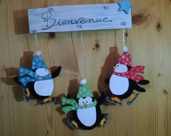 "Three penguins chantournés and painted ""Welcome"""