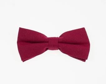 de MORÉ - bold red bow tie