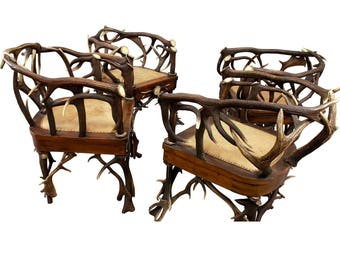 a set of four cabin decor antler armchairs ca. 1900