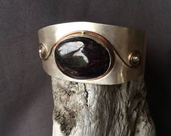 Raw garnet on silver cuff bracelet with copper applique