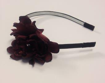 Black headband with maroon flower