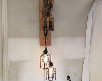 Vintage wooden pulley wall mount fixture.