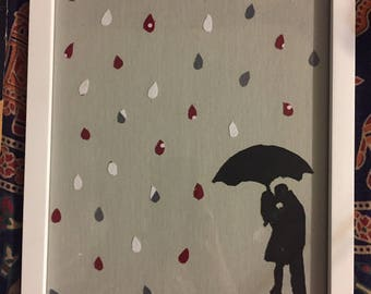 Couple under umbrella in rain