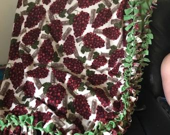 Large soft fleece grape blanket.