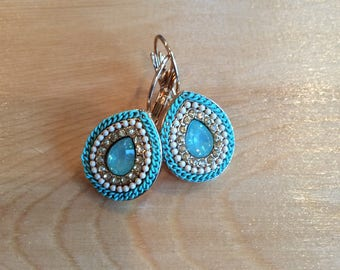Lever back turquoise rope, white beads,and clear cz with a light blue center stone
