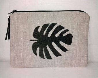 Pouch / clutch in linen with leather tassel monstera leaf