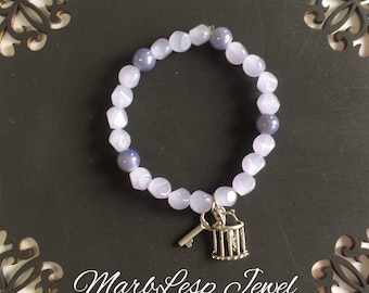 Lilac bracelet with caged birds