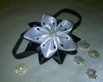 head band or headband with flower made of black and white satin ribbon and black threads