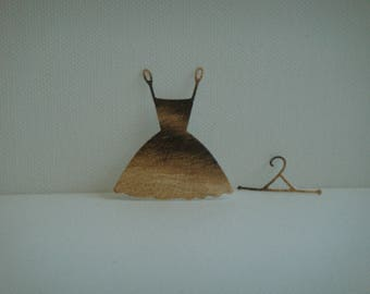Cut little cardboard faux light brown and black zebra with its dress hanger for creation