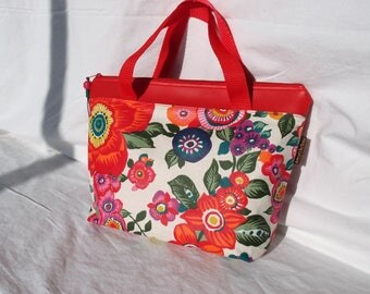 Zippered floral coated canvas and faux red leather Toiletry Kit.