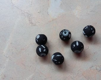 "Satin black with white ""spots"" resin beads. 8mm"