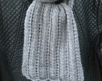 Scarf knitted with needles with a grey thread