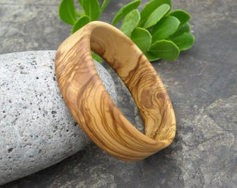 Three bracelets in olive wood