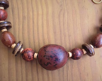 Necklace man donkey, dende paxi seeds and coconut rings / tropical seeds