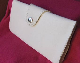 White velvety hand-stitched leather pouch