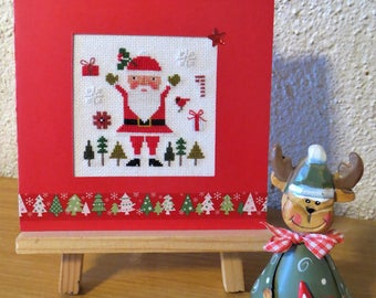 Hand embroidered card: Santa Claus in the trees