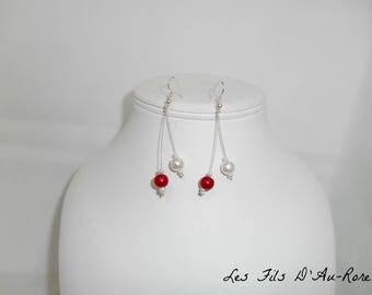 Dangle earrings with red and pearl beads