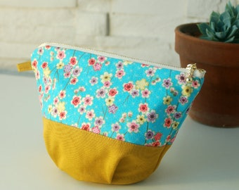 Round pouch with blue and yellow floral Japanese fabric